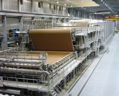 Containerboard being produced at a mill.